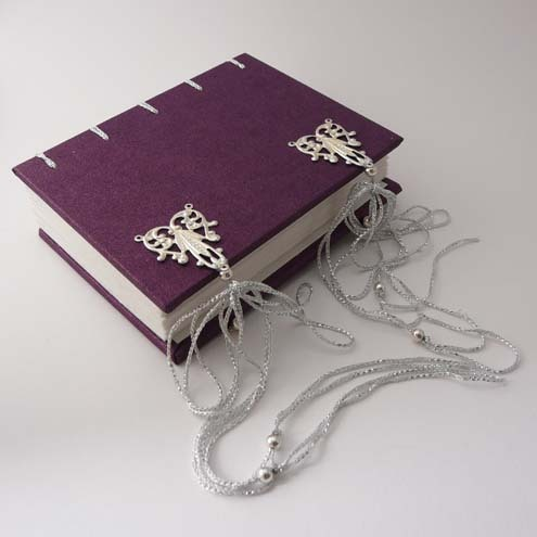 Hand-bound Small Clasped Purple Journal - chain / coptic stitch