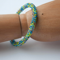 Lime, turquoise and lilac beadwoven bangle
