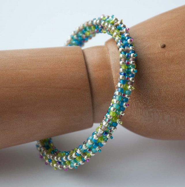 Turquoise, lime, lilac and silver beadwoven bangle