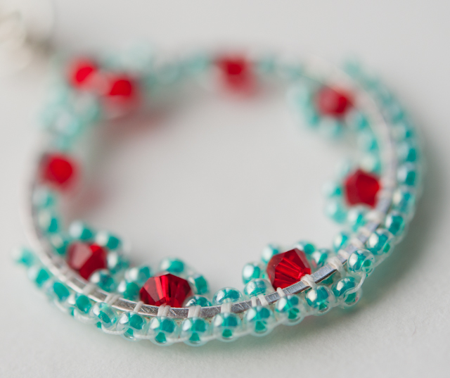 Turquoise, red and silver pendant necklace.
