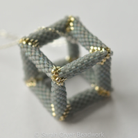 Pale blue and silver hollow beadwoven cube pendant