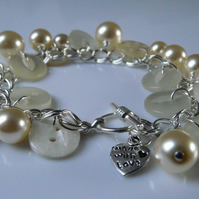 **reserved** Buttons & Pearl Charm Bracelet
