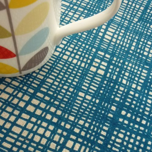weave screen printed fabric in teal blue