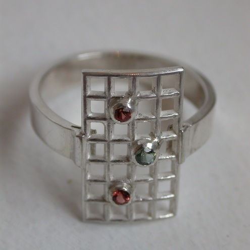 Satin and Sequins Sterling Silver Green Sapphire and Garnet Ring