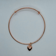 Rose gold plated expanding bangle with heart charm