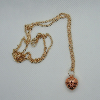 Long rose gold plated necklace with filigree heart charm