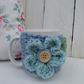 Mug with Chunky Hug Cosy with Large Crochet Flower Detail