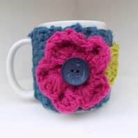 Mug with Chunky Hug Cosy with Large Crochet Flower Winter Berry Colours