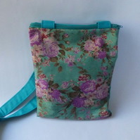 Turquoise and pink floral across body small bag