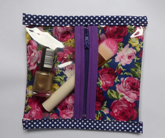 Blue floral cotton and pvc zipped make up bag