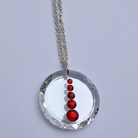 Clear Swarovski crystal element & red rhinestone pendant