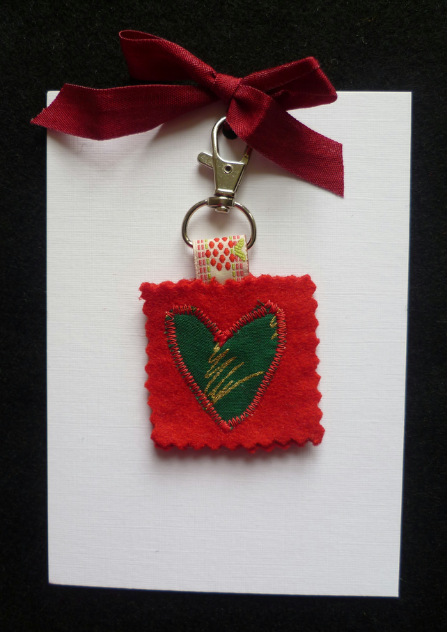 Red wool felt bag charm with green appliqued heart