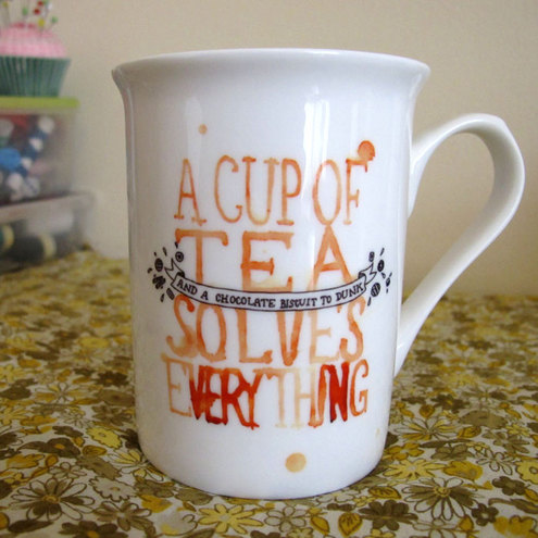 "Bone China ""A Cup of Tea Solves Everything"" Mug"
