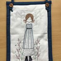 hand embroidered wall hanging, picture. Girl among the flowers.