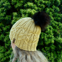 Bobble hat with cable patterning.
