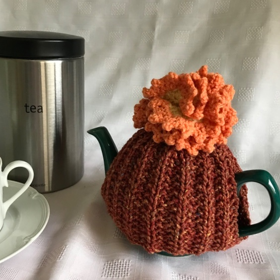 Tea cosy to fit a  2 cup teapot, hand knitted. Charity