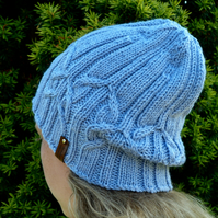 Cable beanie hat. Hand knitted in 100% merino wool