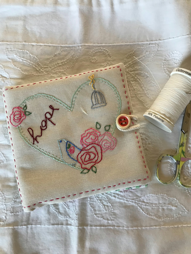 Hand embroidered needlecase. Heart and hope.