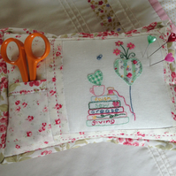 Embroidered pincushion with scissor pocket. Hand embroidered.