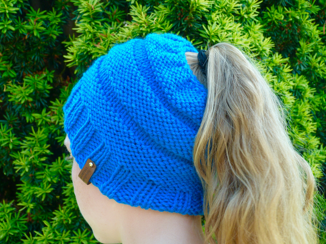 Blue messy bun  or ponytail hat, hand knitted.