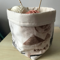 Craft storage basket depicting images of famous landmarks