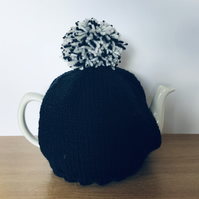 Simple hand knitted tea cosy to suit standard 6 cup teapot. Charity