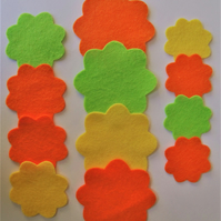 12 Die-Cut Scalloped Edge Felt Flower Shapes in Shades of Orange and Green