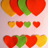 12 Die-Cut Felt Heart Shapes in Shades of Orange, Yellow and Green