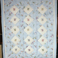 Patchwork Quilt with embroidered Fairies.