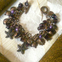 Star Fish, Turtle and Sea Shell  Copper and Aubergine Charm Bracelet