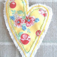 Floral heart-shaped textile brooch