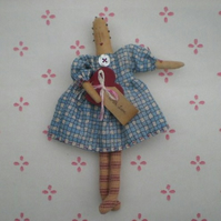 Homespun miniature doll