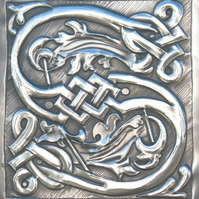 Letter S handcrafted in pewter monogram.