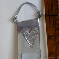 Bathroom mirror decorated with pewter hearts