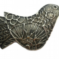 Bird brooch pin.