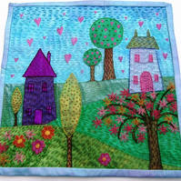 Embroidered textile wall hanging