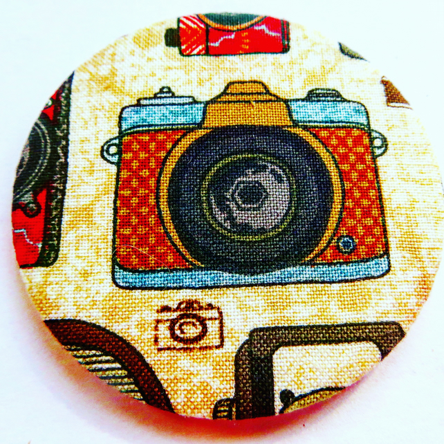 Camera in fabric pocket mirror