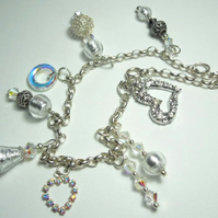 Murano glass a sterling silver bracelet with Swarovski crystals and charms.