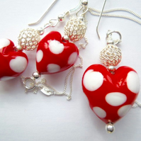 Murano glass red and white polka dot pendant and earrings set.