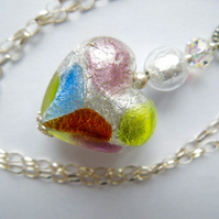 A silver Murano glass heart pendant with sterling silver chain