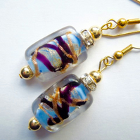 Blue,black and gold Murano glass earrings with gold filled hooks.