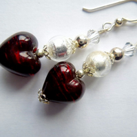 Deep red and silver Murano glass heart earrings.
