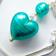 Green Murano glass heart pendant with Swarovski and silver chain.