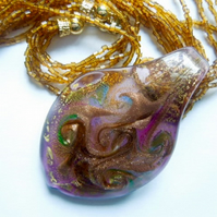 Gold, pink and brown Murano glass pendant with beaded necklace.