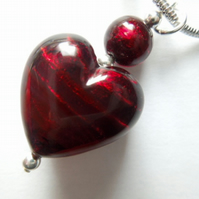 Deep red Murano glass heart pendant with sterling silver chain.