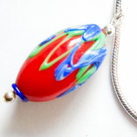Red,blue and green Murano glass pendant with sterling silver snake chain.