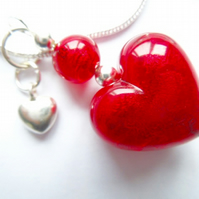 Murano glass red heart pendant with sterling silver charm and chain.