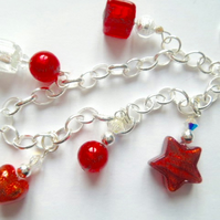 Sterling silver and red Murano glass charm bracelet with Swarovski crystal.