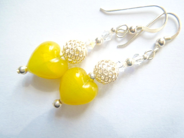 Lemon yellow Murano glass heart earrings with sterling silver hooks.