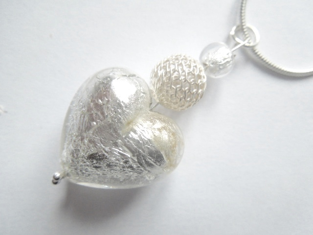Silver Murano heart pendant with sterling silver.